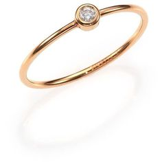 From the Circles Collection. A delicate, brilliant-cut diamond solitaire rests within a bezel setting at the center of an 18k rose gold ring. Diamond, 0.048 ct…