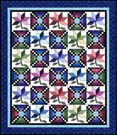 Checkerboard flowers quilt! Free pattern classic cottons.com LOTS OF DIFFERENT PATTERNS I HAD NOT SEEN BEFORE