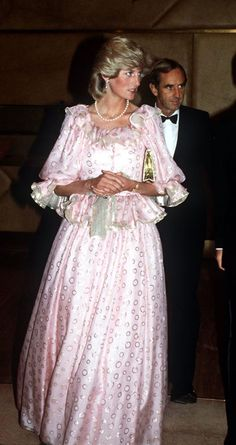 DIANA AT A CONCERT IN AUSTRALIA ON APRIL 14, 1983. GOWN BY CATHERINE WALKER