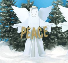 """Peace On Earth Angels Woodcraft Pattern These three large angles hold  the message """"Peace On Earth"""". This will be one yard display you'll be proud of year after year! #diy #woodcraftpatterns"""