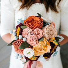 An everlasting bouquet for your everlasting love. Customized felt flowers from @goldenafternoonshop create an heirloom piece designed just for your special day.