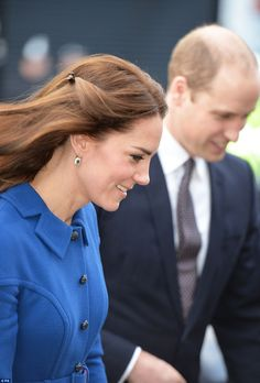 The Duchess accessorised with sapphire and diamond earrings to match her engagement band...