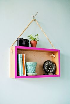 DIY: hanging shelf...i tried this concept before to make my own (floating) book shelf, it turned out very nice -@ahseknovel
