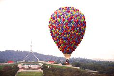 """Disney fanatics, hold on tight. There's an actual life-size hot air balloon inspired by Up floating above Canberra right now. 