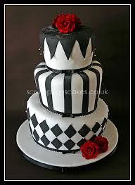 Find black wedding cake inspiration with our gallery of black wedding cakes. See pics of black and white wedding cakes, black and red wedding cakes, steampunk and more. Black And White Wedding Cake, Black Wedding Cakes, Beautiful Wedding Cakes, Beautiful Cakes, Amazing Cakes, Black White, Cake Wedding, Red Wedding, Wedding Ideas