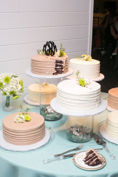 beautiful, separate specialty wedding cakes on glass jars as cake stands ~ LOVE!!!