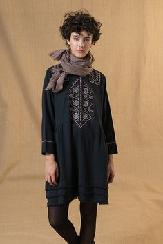 Long sleeved dres with embroidery in the front.