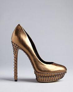 """Brian Atwood """"Finvarra"""" Platform Pumps in Gold... I'm so in love with these."""
