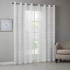 Features:  -Lightweight sheer fabric.  -Burnout detailing.  -Geo pattern block design.  Product Type: -Single panel.  Pattern: -Geometric.  Cleaning Method: -Machine washable. Dimensions:  Panel Width