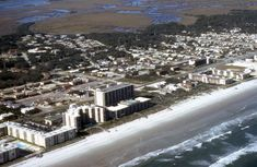 The beachside area of New Smyrna Beach Florida is developed along a small barrier island separated from the mainland by marshes and the Intracoastal Waterway.