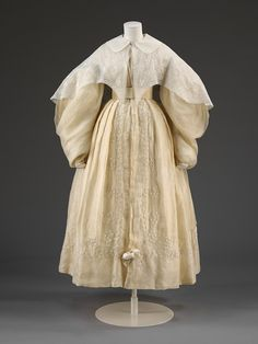 Wedding dress, England, 1834, muslin embroidered with cotton and lined with silk. Victoria & Albert Museum.
