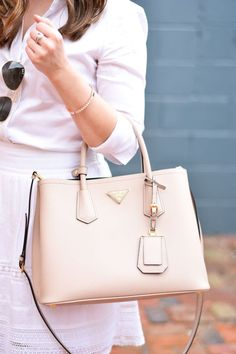 We love the subtle hues of this outfit and Prada bag.