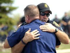 Michigan State Police Trooper Marc Trammell, left,