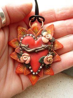 Just one of Marie Segal's gorgeous Sacred Heart series of PC jewelry. Sadly, this one is already sold.
