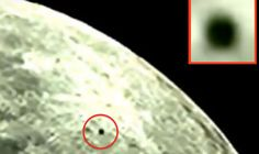 """A STRANGE """"disc-like"""" UFO filmed passing the moon has ET chasers convinced aliens are investigating the lunar surface."""