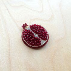• Hand Embroidered Pomegranate Brooch - Made to order • This is an example of the Pomegranate brooch which can be made for the custom order. Many cultures of the world regard the pomegranate as a symbol of life, love, prosperity, fertility and abundance. The medieval Latin name of the
