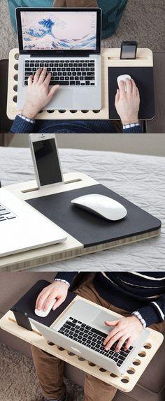 Столик для ноутбука с выделенным местом под мышку и смартфон. Специальные отверстия в столешнице обеспечивают работу кулера в ноутбуке