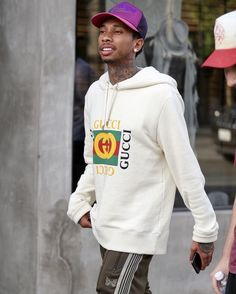 Tyga Wears a Gucci Hoodie, Bape Hat and Needles Track Pants  |  UpscaleHype