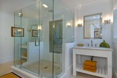 Huge shower placed in the middle of the bath to divide the space for his and her vanities