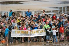 """Cromer staged an impressive beach event to win a """"Stand on the sand"""" challenge against Sheringham. Hundreds, of locals and visitors packed 'East beach' in spectacular style to smash the 300 target set by the neighbouring town."""