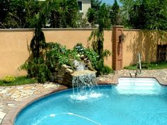 Pool Waterfall Ideas find this pin and more on custom water feature swimming pools garden ponds and backyard landscaping pools with waterfalls swimming pool designs Pool Waterfall Idea