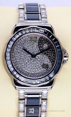 TAG Heuer Formula 1 Lady Yin Yang- black diamonds and white diamonds in a white gold case- part of the TAG Heuer women's range of watches as jewellery
