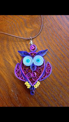 Quilled owl pendant