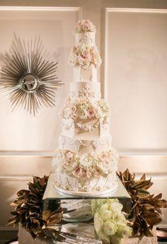 Glamorous wedding cake table; photo: Samuel Lippke