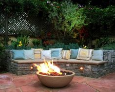 """Warm up a chilly afternoon or add drama to an evening with a fire pit, like the one landscape designer Deborah Gliksman installed on this California property. """"Think about the flow of the patio when you decide where to place your fire pit,"""" says Deborah. """"You want to have ample seating around it to get maximum enjoyment."""""""