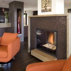 Mosaic tile fireplace surround. Camber Construction Oakland Hills remodel.