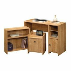 Office-in-a-Box by sauder. $93.95. file holds letter-size hanging files. includes desk, bookcase and file stand. Includes desk, bookcase and file stand. Desk features an adjustable shelf and hidden storage behind door. Bookcase features an adjustable shelf. File stand with gallery shelf holds letter-size hanging files. Quick and easy assembly with patented T-slot drawer system. Highland Oak finish.