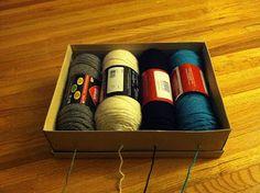 Smartest idea ever! Poke holes in a shoebox to keep yarn neat!
