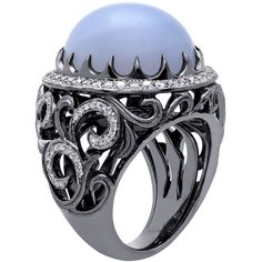 Chalcedony Scroll Fashion Ring - A 22.28 ct. cabochon chalcedony is accented with 0.87 ct. t.w. round diamonds in this 18k white gold, black rhodium-plated scroll-designed ring.