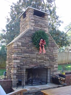 Stacked stone fireplace constructed as part of an outdoor kitchen - Renovation by Penn Carpentry, Atlanta General Contractor #renovation #homeimprovement