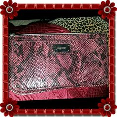 Nine West wristlet NEW without tags!  5H X 9.5L.     SNAKESKIN EMBOSSED PYTHON FAUX LEATHER IN BERRY AND BLACK ZIP CLOSURE SILVER HARDWARE WRIST STRAP ANIMAL PRINT INTERIOR  6 CARD SLOTS ZIPPER POCKET Nine West Bags Clutches & Wristlets