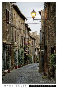 Quaint italian side street | lanterns in Italy | A Viterbo, Italy Destination Wedding | All-Inclusive Wedding Packages | Storytellers Events http://www.storytellersevents.com/blog/a-viterbo-italy-destination-wedding/