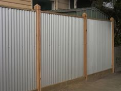 Corrugated Iron Fence/I really like this idea. Why didn't I see this before we put in our wooden one?