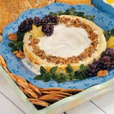 Blue Cheese Walnut Cheesecake Recipe -This elegant party spread is smooth and creamy and has a mild blue cheese flavor. It's popular every time I serve it. Garnished with chopped walnuts, it looks like you fussed, but it's not that tricky to prepare. -Rita Reifenstein, Evans City, Pennsylvania