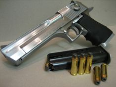 Desert Eagle 44 Magnum... do I want it? Yes! Could I shoot it? Maybe my husband will buy me one so that I can find out :)