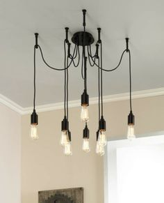 Multiple hanging bulb lights or cluster lights make a striking epitome of modern industial lighting we love the chic industrial style of this adjustable chandelier europa 1910 edison bulb bronze multi light pendant aloadofball Choice Image