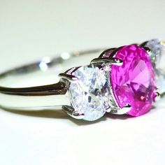 Size 7.5 Sterling Silver Pink  & Clear CZ Ring .925 Sterling Silver Pink fuchsia and Clear CZ oval shape 3 stone style woman's Gorgeous Ring Size 7.5 Very good condition Shipped with a Ring box to the buyer Famine style Great for Christmas gift Jewelry Rings