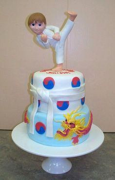 TKD cake with Korean Dragon winding around the bottom tier...