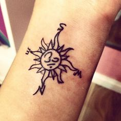 om, sun, compass tattoo... Don't know what's in the middle but I love the sun plus compass!