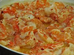 Traditional Garlic Shrimp from Food.com:   								I got this recipe many years ago from a local restaurant in New Jersey. The restaurant is still there, so I know this is a good one ! When I tell people how easy it is, they are always surprised.  You can serve this over rice as a main course (yellow or white rice), or just serve it in the casserole dish with plenty of delicious Portuguese bread.