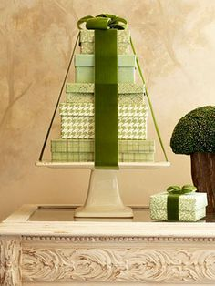 Stack up some gorgeously wrapped boxes on a cake stand.   Add a BIG Bow and you have a  Christmas tree on your table.