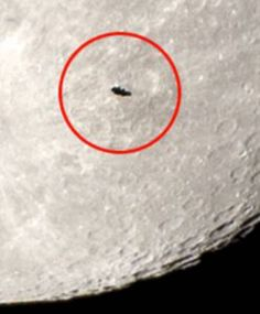 UFO transiting the moon on the night of the super moon JULY 2014