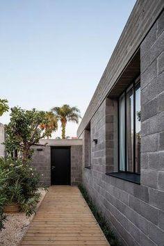 Israeli architect couple use concrete blocks to build themselves a home among fruit trees Concrete Block Walls, Concrete Facade, Exposed Concrete, Concrete Houses, Cinder Block House, Cinder Block Walls, Modern Exterior, Exterior Design, Loft Estilo Industrial