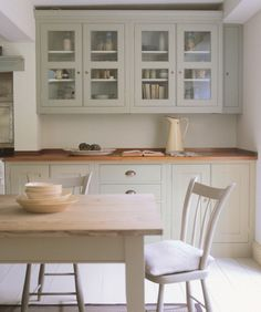 Plain English kitchen with units painted in Farrow and Ball French Gray, table