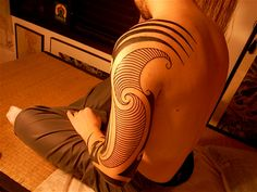 Gorgeous tribal tattoo with mixed style for shoulder and left arm. Elegant and well done!
