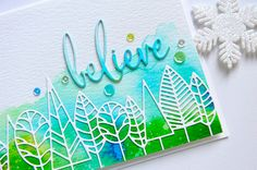 Today I am using a beautiful die called Boddington Tree Border along with a fun new sentiment die called Fancy Believe. For this card, I used watercolor paper and Peerless watercolors. I used several different shades of blues and greens and just dabbed them along the bottom of the watercolor paper, letting it blend and run a bit. When this was dry, I cut the Boddington Tree Border out of white card stock and glued this along the very bottom...